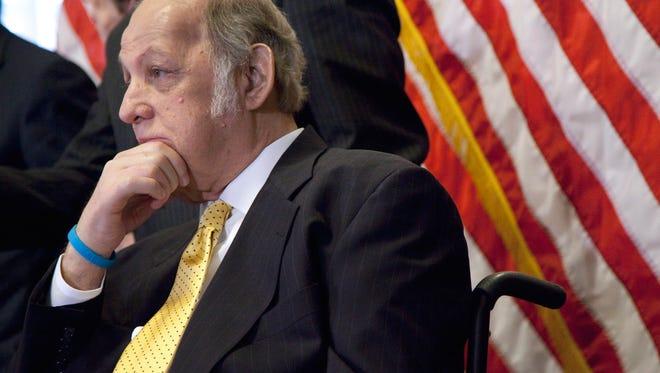 This March 30, 2011 file photo shows former White House press secretary James Brady who was left paralyzed in the Reagan assassination attempt during a news conference on Capitol Hill in Washington marking the 30th anniversary of the shooting. A Brady family spokeswoman says Brady has died at 73.