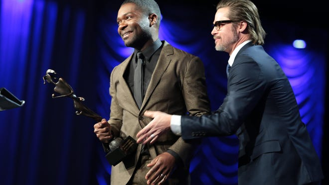 David Oyelowo is shown receiving the Breakthrough Performance Award from Brad Pitt at the 2015 Palm Springs International Film Festival Awards Gala.