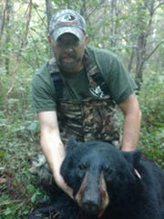 T.J. Boisvert with a nice bear he tagged this fall.