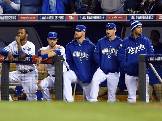 Royals react from the dugout as the Giants win the