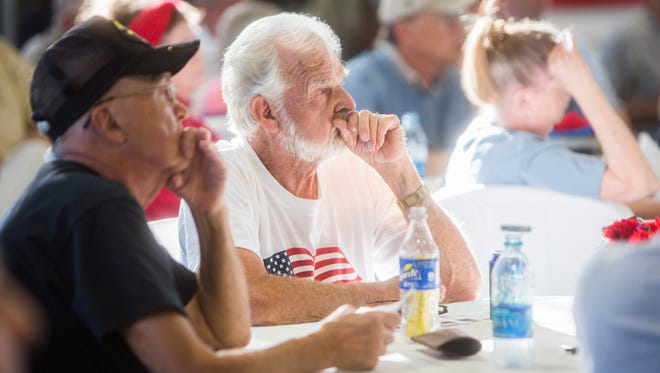 Randy Graham of Oconee listens during a town hall meeting Monday at the Townville Fire Department regarding the conflict  between the county and Pioneer Rural Water District..