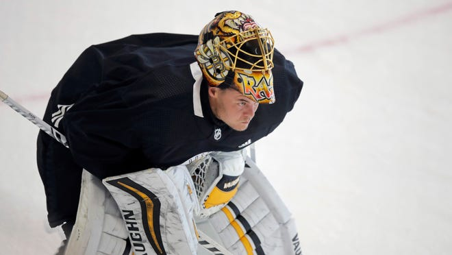 Boston Bruins goaltender Tuukka Rask skates away from the crease with his mask up at the NHL hockey team's camp on Tuesday, July 14, 2020, in Boston.