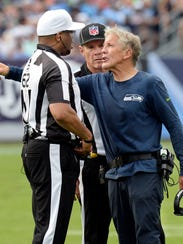 Seattle Seahawks head coach Pete Carroll argues with
