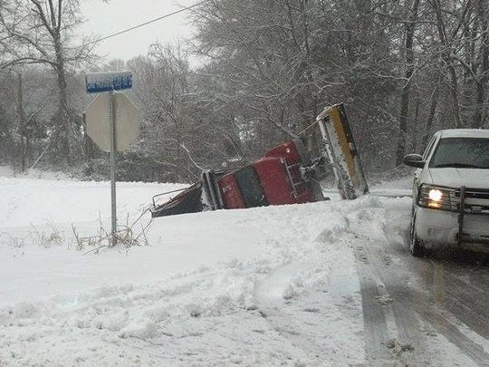 A plow became stuck on Highway 12 on Friday while trying