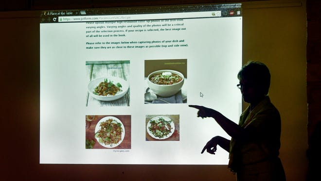 Jane Oxton points to highlights of the A Place at the Table website during a  meeting on Aug. 10 at the Paramount Center for the Arts in St. Cloud. Recipes submitted from community members will be featured on the website, and a cookbook will be created as part of the project.