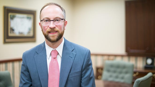 Christopher Opper of Fairport is a financial adviser with Regent Financial Group in Pittsford.