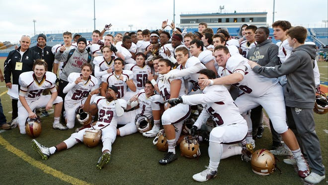 Iona Prep defeats Holy Trinity 35-14 to claim the CHSFL AA championship title at Mitchel Athletic Complex in Uniondale on Saturday, November 19, 2016.
