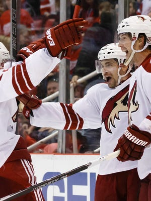 The Coyotes' Mark Arcobello (center) celebrates his winning goal with Oliver Ekman-Larsson (left) and Shane Doan against the Red Wings on March 24, 2015.
