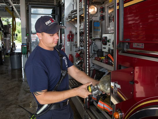 Firefighter EMT, Landon Ross, performs routine checks