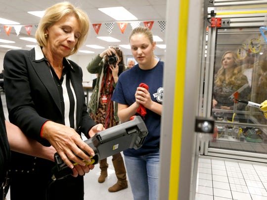 U.S. Secretary of Education Betsy DeVos is shown how
