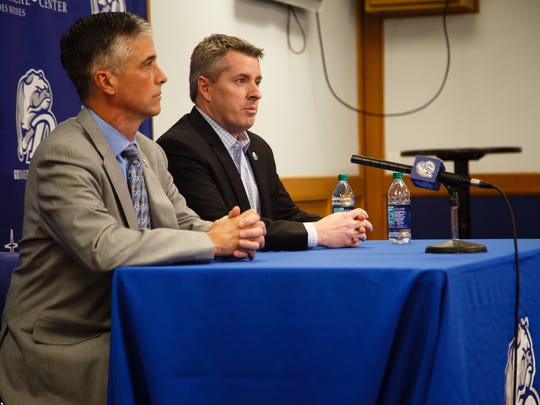 Drake President Marty Martin, left, and Athletic Director Brian Hardin, right, speak to the media after head mens basketball coach Niko Medved announced he was leaving for Colorado State on Thursday, March 22, 2018, in Des Moines.