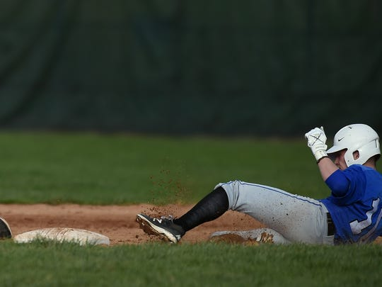 Centerville's Trey Wilson slides safely into second base against Seton's Vincent Mosey Saturday, April 1, 2017 during a baseball game on John Cate Field at McBride Stadium in Richmond.