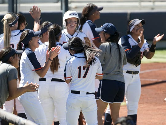 UTEP players celebrate a run in their game against Western Kentucky Saturday at Helen of Troy softball complex.