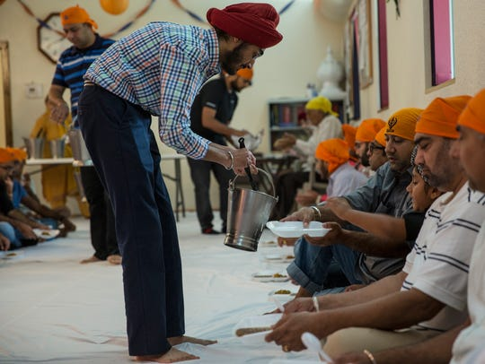 JJ Singh Kapur, a senior at Valley High School, helps