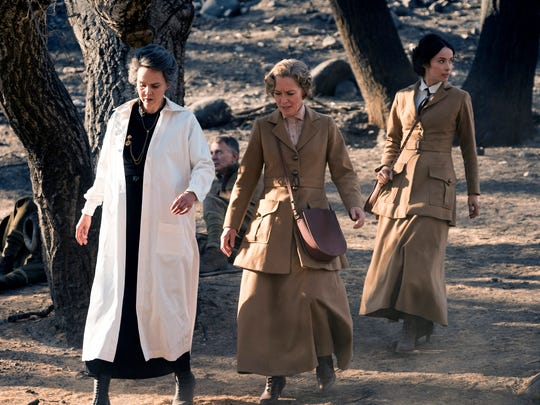"Marie Curie (Kim Bubbs, far left, with Susanna Thompson and Abigail Spencer) is among the trailblazing women featured in the second season of ""Timeless."""