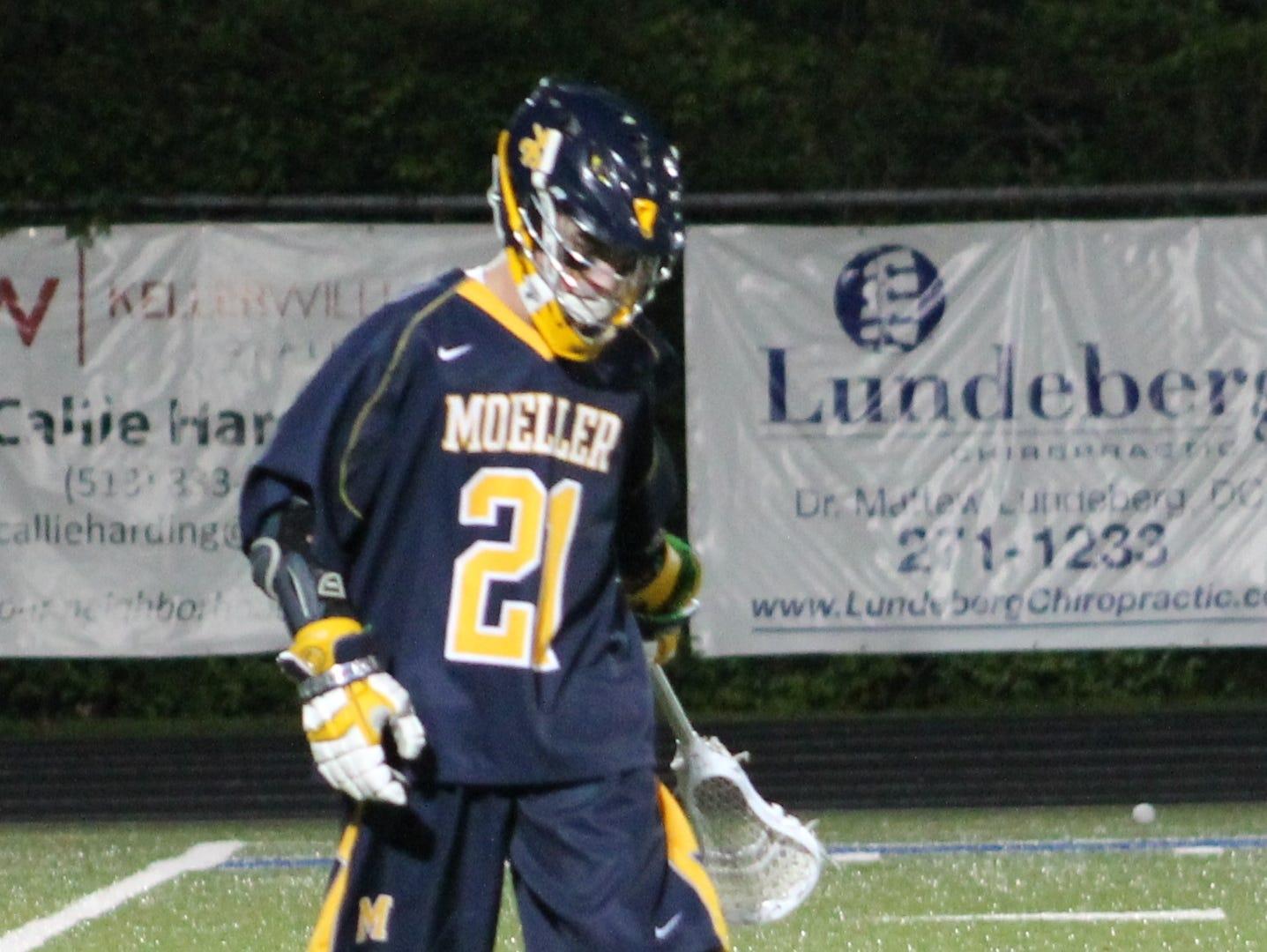 Moeller senior Grady Quinn walks off after a Crusader goal.