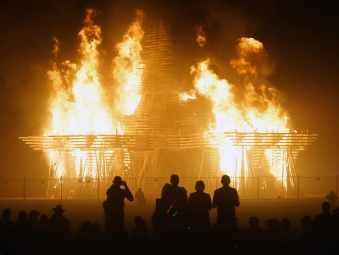 Burning Man attendees watch the Temple burn on Sept.