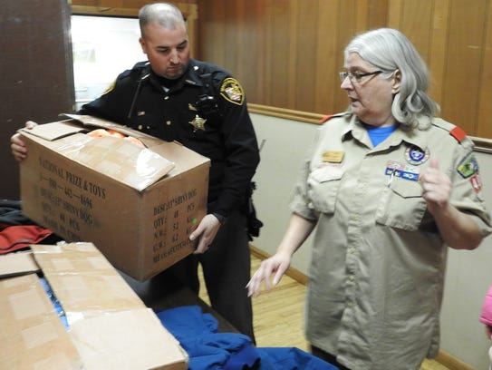 Deputy Morgan Landis accepts a donation of Shiny Dogs