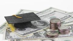 A graduation cap and a pile of money.