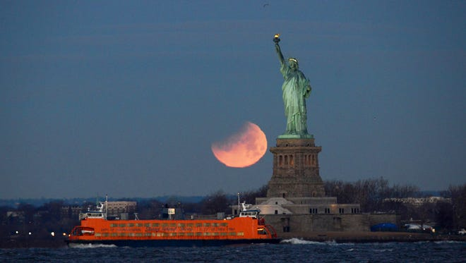A rare lunar trifecta, a Supermoon, Blue moon and a lunar eclipse occurs simultaneously on the morning of Wednesday, January 31, 2018. The last time that the moon went through this event was in 1866. The photo was taken from the Brooklyn Cruise Terminal.