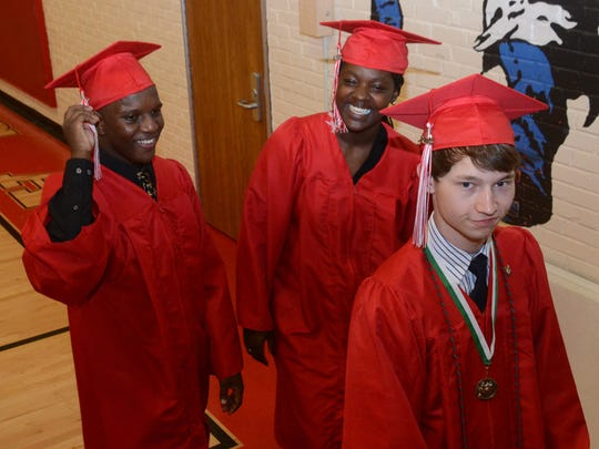 Members of the Tioga High School Class of 2015 walk out to the football field as commencement ceremonies begin Friday. The school celebrated its 100th year.