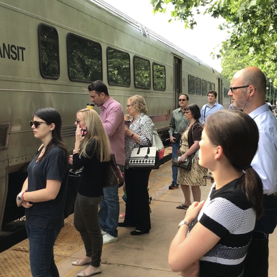 Commuters about to board an NJ Transit train to New