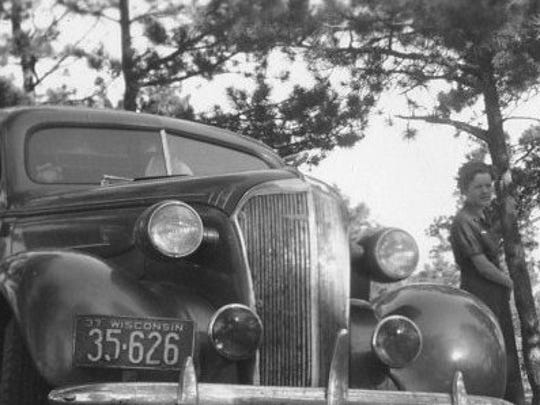 Ethel Rasmussen is seen with the 1937 Chevrolet two-door that took her and new husband Earl across the county.