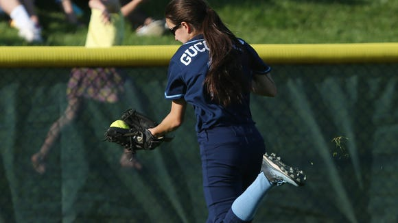 Suffern's Nicole Guccione makes an over-the-shoulder catch to save a couple of runs against Yorktown during girls softball playoff action at Yorktown High School May 23, 2018. Yorktown won the game 4-1.