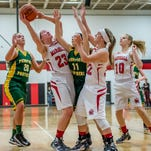 Marshall's Emily Delmotte (21) takes her shot against Pennfield Friday evening.
