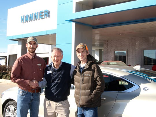Jim Clark (center), executive director of the Christian Service Center of Abilene, receives the keys to a Chevrolet Impala from Chase Hanner (left) and Hunter Hanner (right). The Hanner family has been a long-time supporter of the Service Center.