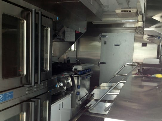 A full kitchen with walk-in freezer helps keep volunteers