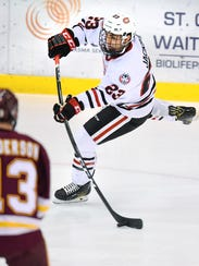 St. Cloud State's Robby Jackson slaps the puck in to