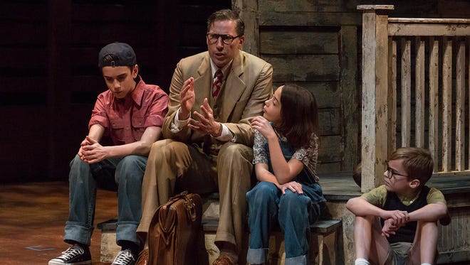 "Grayson Molin (from left), Ryan Artzberger, Paula Hopkins and Mitchell Wray star in the Indiana Repertory Theatre's 2016 production of ""To Kill a Mockingbird,"" adapted from Harper Lee's Pulitzer Prize-winning novel."
