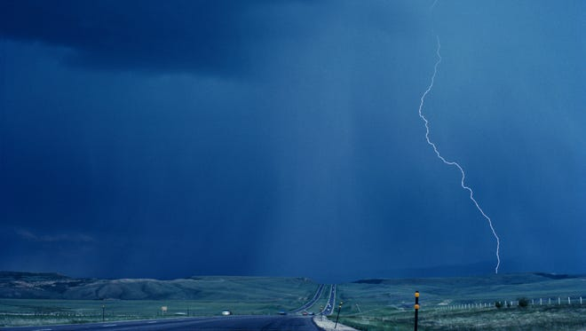 A file photo showing lightning and rain during a thunderstorm. Reno forecasters expect thunderstorms to hit the Sierra over weekend, putting a damper on any outdoors plans.