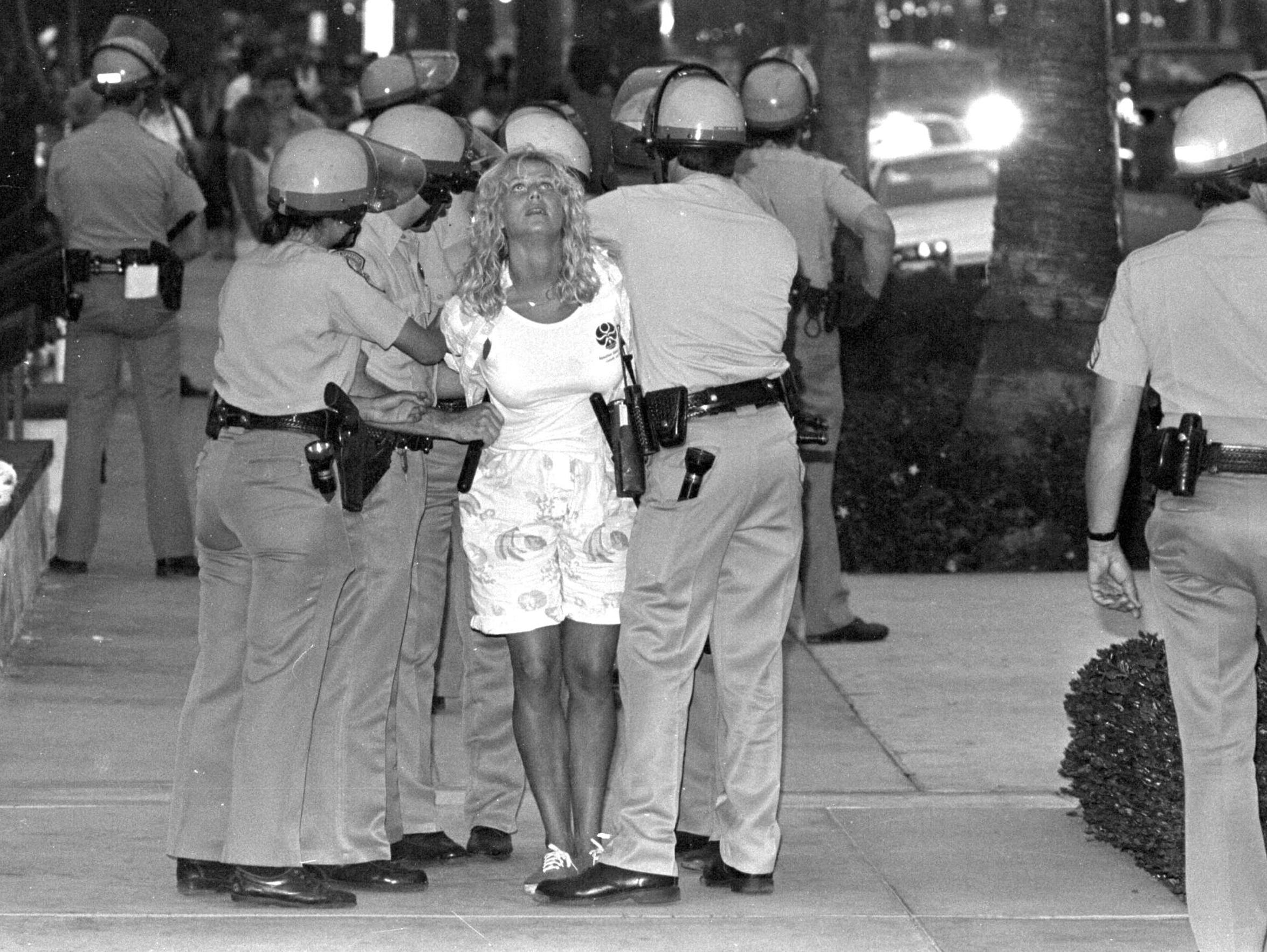 Palm Springs police arrest a spring breaker during a riot in March 1986. Hundreds of people were arrested and police ultimately had to use tear gas to disperse the mob