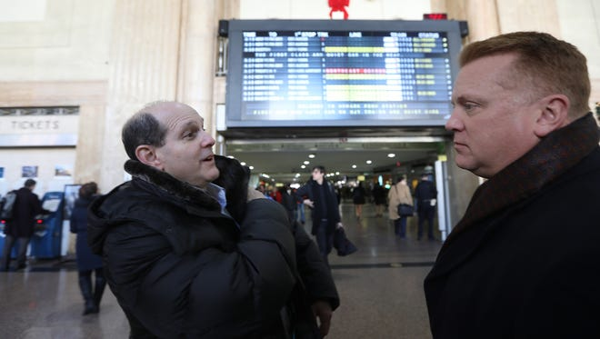 Marc Pasternak of Mountainside and Shawn Hanna, also of Union County, are shown at Newark Penn Station. The two met after the New Jersey Transit busses they were riding bumped into each other after being diverted to Secaucus Junction Station.  Both men were on their way to Port Authority in New York City, on their way to work.  Pasternak considers himself especially lucky because he said today's bombing took place on the concourse he uses.  In addition, on 9/11 his office was across the street from the World Trade Center.  Although his building was heavily damaged, he was in Canada that day on a business trip.  There were no injuries on either of their busses and they believe there was no damage.   Monday, December 11, 2017