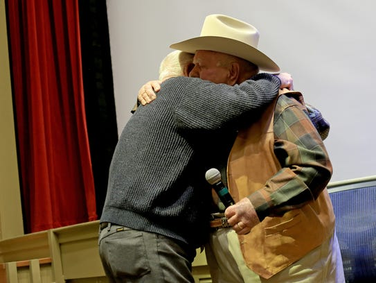 Actor Wilford Brimley, right, hugs an old friend during