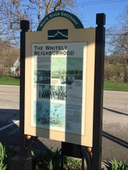 The Whitely Neighborhood sign along White River in