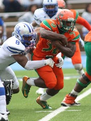 Gerald Hearns looks for yardage during FAMU's 33-0 loss to the Pirates