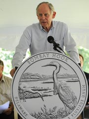 Former U.S. Rep. Mike Castle speaks Friday at the launch of Delaware's new quarter in the America the Beautiful Quarters Program at Bombay Hook National Wildlife Refuge near Smyrna. Castle is credited as the man behind the specialty quarter program.
