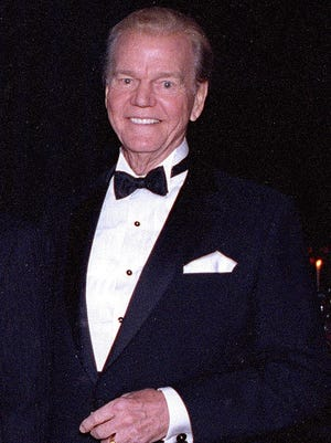 Paul Harvey poses at the National Radio Hall of Fame in Chicago, Nov. 15, 1992. The broadcasting pioneer was heard by more than 20 million listeners at a time. A new museum devoted to his life opened Nov. 4, 2016 in Branson.