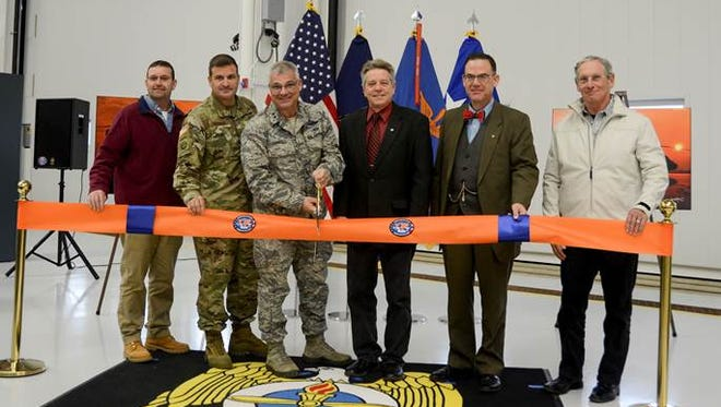 Maj. Gen. Tony Carrelli, Pennsylvania's adjutant general, cuts the ribbon dedicating the Eastern Army National Guard Aviation Training Site's (EAATS) new Aviation Maintenance Instructional Building (AMIB) Nov. 13 at Fort Indiantown Gap. From left to right, Doug Boltz, general manager of Senate Builders, Lt. Col. Todd Tuttle, EAATS commander, Carrelli, Pa. state rep. Russ Diamond, Robert DeSouza, state director for U.S. Sen. Pat Toomey, and Bruce Shapiro, chief operating officer at Boro Construction joined in the ceremony.