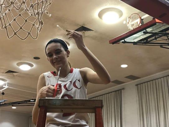SJCC senior Adrienne Wehring celebrates an outright