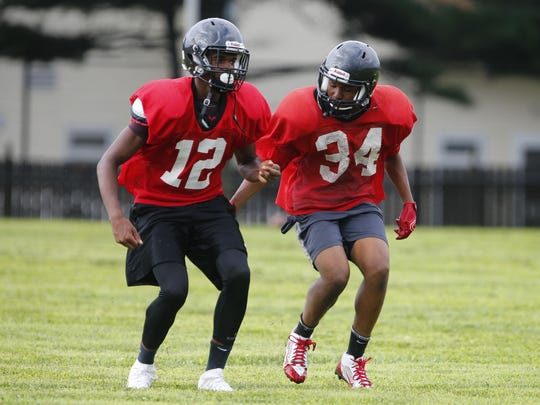 Kahmar Rice (12) and Marvin Morgan (34) practice at