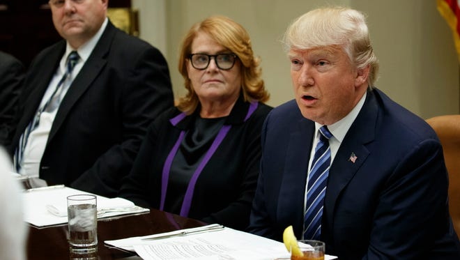 Sen. Jon Tester, D-Mont., left, and Sen. Heidi Heitkamp, D-N.D., center, listen as President Donald Trump speaks during a meeting with Senators on his Supreme Court Justice nominee Neil Gorsuch, Thursday, Feb. 9, 2017, in the Roosevelt Room of the White House in Washington.