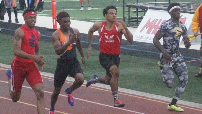 Westland John Glenn's Jaron Flournoy (far left) placed first in the 100- and 200-meter dashes at Saturday's D1 state meet.