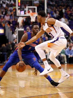 Detroit Pistons guard Reggie Jackson dribbles against Phoenix Suns guard Shaquille Harrison during the first half Tuesday, March 20, 2018 in Phoenix.