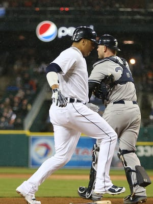 Tigers designated hitter Victor Martinez scores against the Yankees during the eighth inning of the Tigers' 2-1 win Monday at Comerica Park.