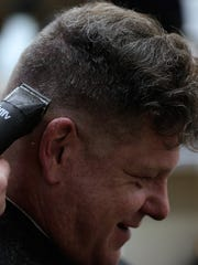 Green Bay resident Paul Neuser gets a trim at Russ's Barber Shop in Green Bay.