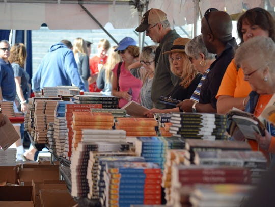 Book lovers enjoy shopping at the Parnassus tent at